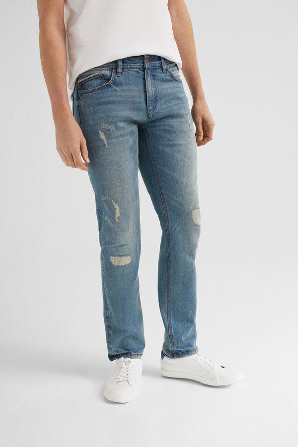 12e431816f Springfield Denim slim lavado medio-claro con rotos azul · Comprar