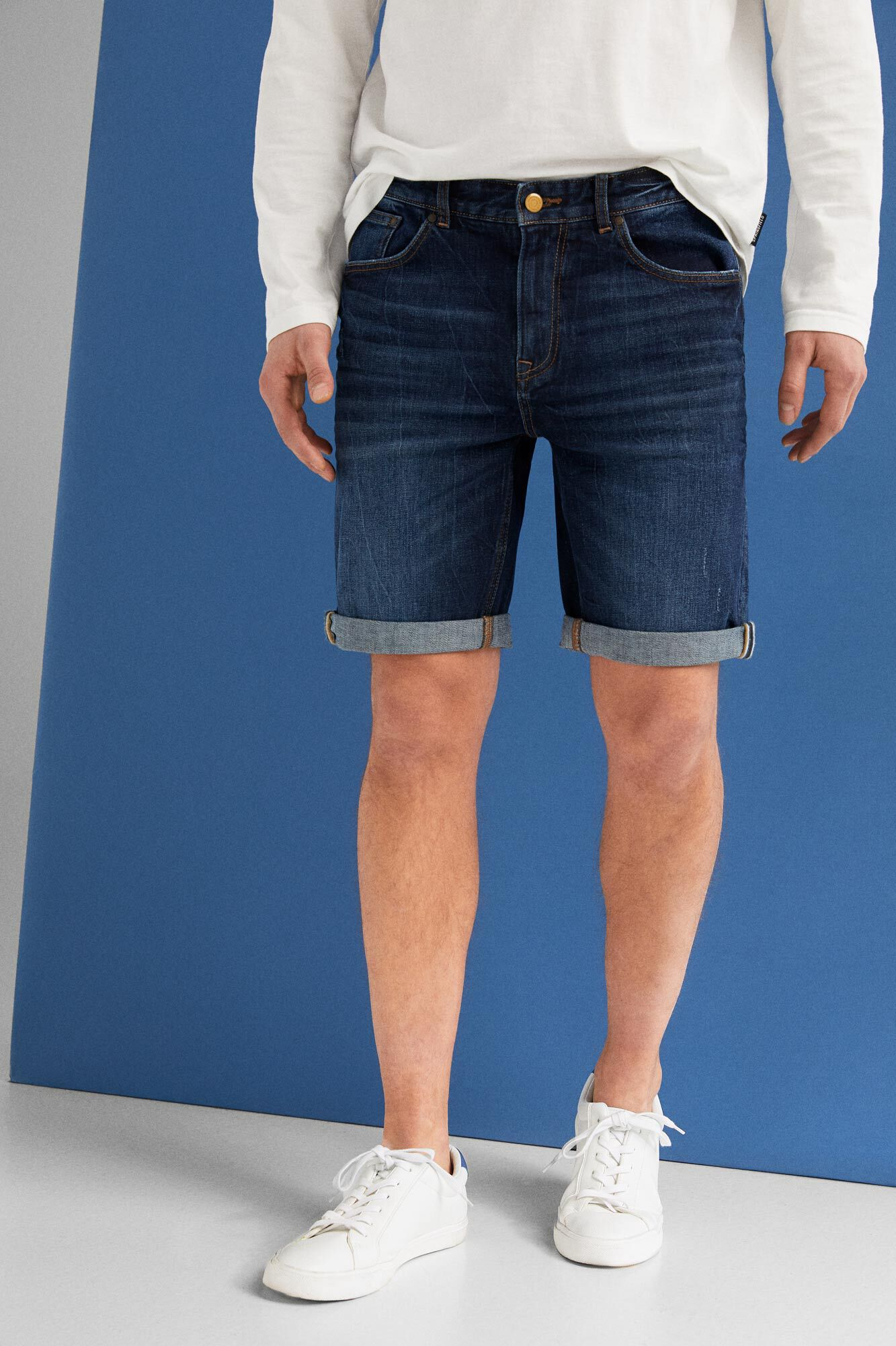 7cba7973f Springfield Calções jeans regular vintage lavagem escura azul